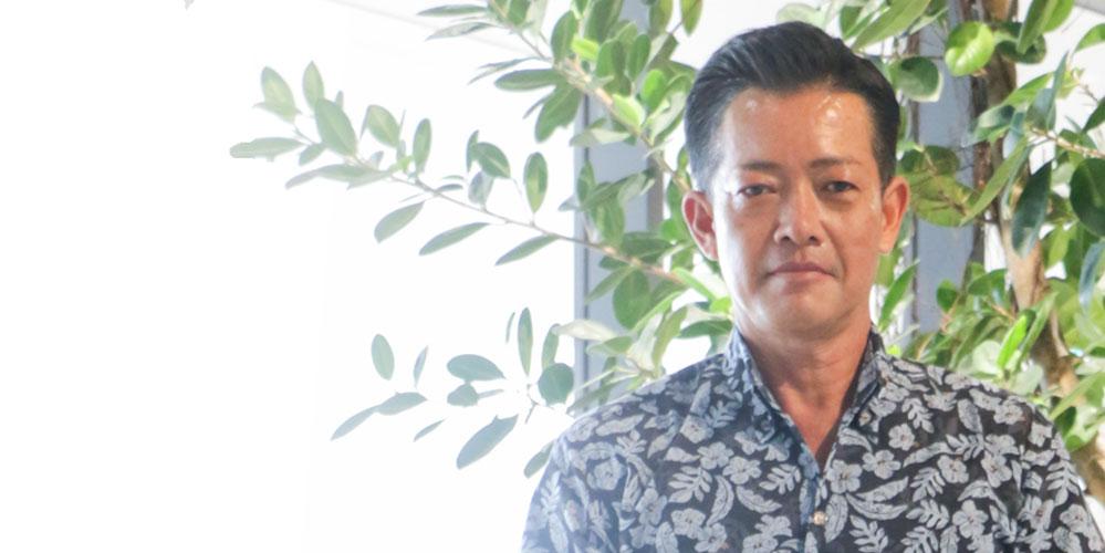 写真:代表取締役社長 金城 清典
